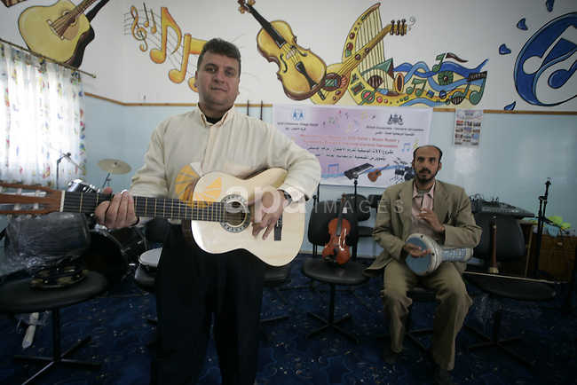 A Palestinian men play on musical instruments at the SOS Children's Village in Rafah, the southern Gaza Strip on October 19, 2009.The school for orphans that was established in 2000 with the sponsorship of the Austrian SOS international, faces the threat of closure because of the longstanding Israeli blockade on the Gaza Strip. Photo by Abed Rahim Khatib