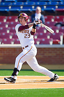 Nick O'Shea #23 of the Minnesota Golden Gophers follows through on his swing against the Towson Tigers at Gene Hooks Field on February 26, 2011 in Winston-Salem, North Carolina.  The Gophers defeated the Tigers 6-4.  Photo by Brian Westerholt / Four Seam Images