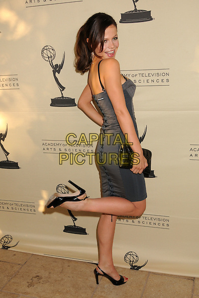 TAMMIN SURSOK.2008 Daytime Emmy Nominee Reception at Wilhelm's Savannah Restaurant, Burbank, California, USA..June 9th, 2008.full length grey gray dress lace-up looking over shoulder clutch bag purse mouth open leg up kicking .CAP/ADM/BP.©Byron Purvis/AdMedia/Capital Pictures.