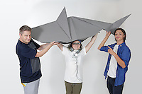 OrigamiUSA 2016 Convention at St. John's University, Queens, New York, USA. Oversized 9' x 9' paper folding event. First timers. Left to right: unknown, unknown, unknown.