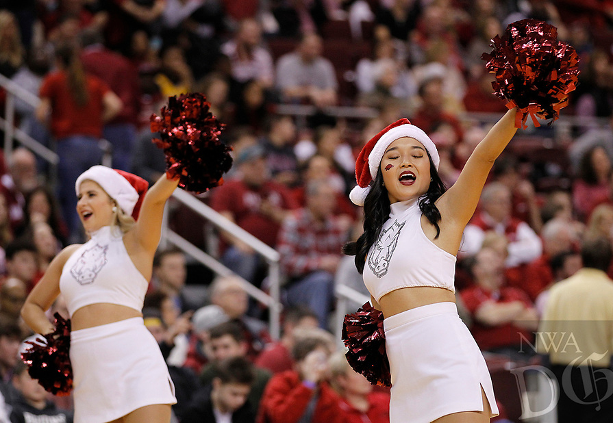 Arkansas Democrat-Gazette/THOMAS METTHE -- 12/16/2018 --<br /> Arkansas cheerleaders lead a cheer during the second half of the Razorbacks' 79-67 win on Saturday, Dec. 15, 2018, at Verizon Arena in North Little Rock.