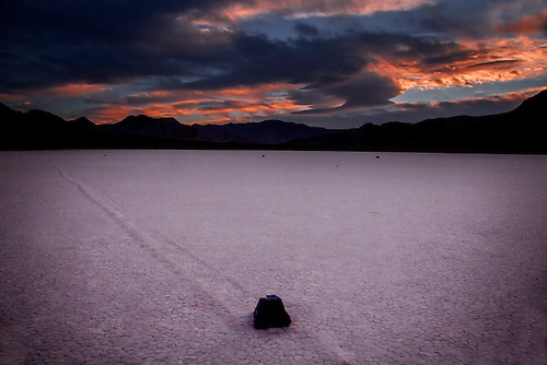 The sun sets on the moving rocks at Racetrack Playa at Death Valley National Park