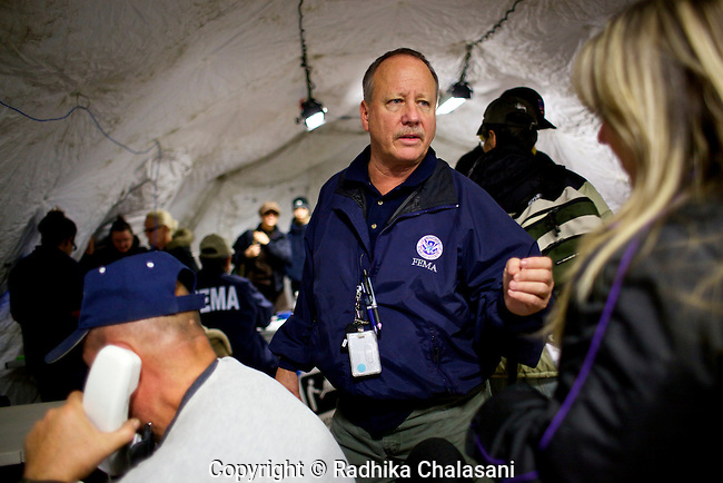 NEW DORP BEACH, NEW YORK-NOVEMBER 3: FEMA manager, Clete Strayer, advises a victim of Hurricane Sandy at New Dorp High School in the aftermath of Hurricane Sandy November 3, 2012 in the Staten Island borough of New York City. Staten Island saw an influx of assistance today as it tries to recover from the devastating storm that left 19 dead on the island.