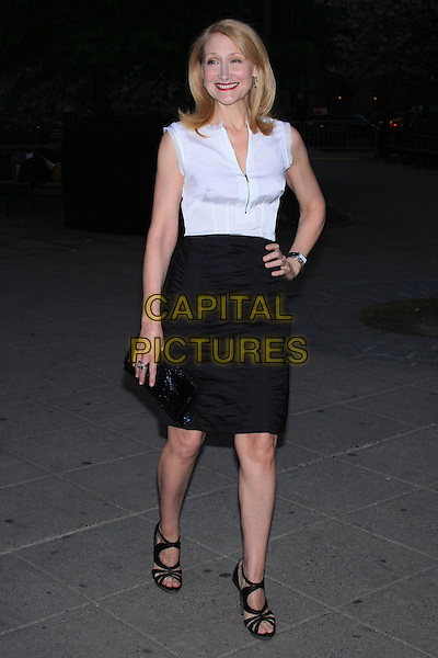 PATRICIA CLARKSON.Attend the 9th Annual Tribeca Film Festival Vanity Fair Party held at the New York State Supreme Courthouse, New York, NY, USA.              .April 20th, 2010.full length black skirt white sleeveless top hand on hip ruched zip zipper .CAP/LNC.©TOM/LNC/Capital Pictures.