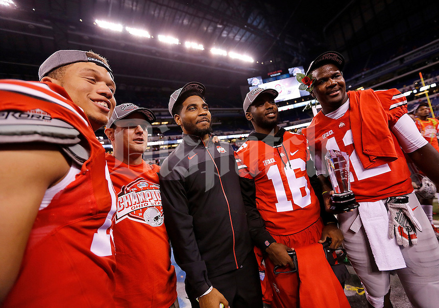 Ohio State Buckeyes quarterback Stephen Collier (13), asst. coach Tom Herman, Braxton Miller, J.T. Barrett and Ohio State Buckeyes quarterback Cardale Jones (12) following the Big Ten Championship game at Lucas Oil Stadium in Indianapolis on Saturday, December 6, 2014. (Columbus Dispatch photo by Jonathan Quilter)
