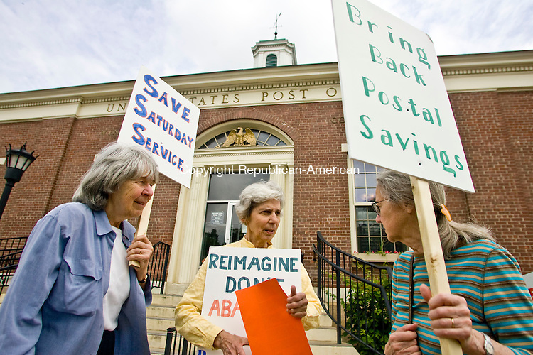 WINSTED, CT - 29 MAY 2010 -052910JT01-<br /> From left, Dorothea DiCecco of Litchfield, Claire Nader of Winsted and Caroline Webster of North Canaan hold signs in front of the Winsted Post Office during a demonstration Saturday morning in protest of recent proposals to raise rates and curtail services.<br /> Josalee Thrift Republican-American