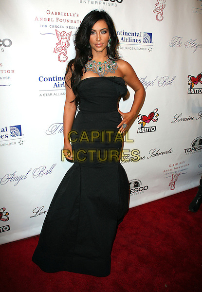 """KIM KARDASHIAN.Gabrielle's Angel Foundation for cancer research hosts """"Angel Ball 2010"""", New York, NY, USA..October 21st, 2010.full length black strapless dress diamonds green emerald necklace fishtail hand on hip .CAP/ADM/PZ.©Paul Zimmerman/AdMedia/Capital Pictures."""