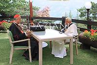 Pope meets with Vatican Secretary of State Cardinal Tarcisio Bertone, in the garden of the house of Les Combes in northern Italy, where he spends his vacanze.Les Combes 22.07.2009.