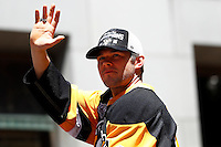 Chris Kunitz #14 of the Pittsburgh Penguins waves to the crowd during the Stanley Cup victory parade in downtown Pittsburgh, Pennsylvania on June 15, 2016. (Photo by Jared Wickerham / DKPS)