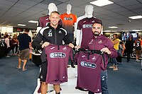 Pictured: Lee Trundle and Leon Britton with the new kit. Friday 24 August 2018<br /> Re: Swansea City FC third kit launch at the club shop, Liberty Stadium, Swansea, Wales, UK.