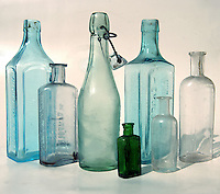 Old different shaped empty bottles.