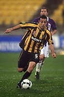 Phoenix' Diego Walsh takes the ball forward during the A-League football match between Wellington Phoenix and Perth Glory at Westpac Stadium, Wellington, New Zealand on Sunday, 16 August 2009. Photo: Dave Lintott / lintottphoto.co.nz
