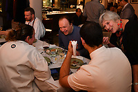MELBOURNE, 30 June 2017 – Philippe Mouchel and Sasha Randle talk at their table during a dinner celebrating his 25 years in Australia with six chefs who worked with him in the past at Philippe Restaurant in Melbourne, Australia.