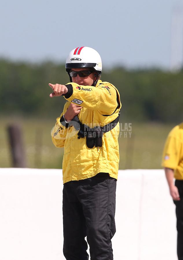 Apr. 28, 2013; Baytown, TX, USA: NHRA a Safety Safari member during the Spring Nationals at Royal Purple Raceway. Mandatory Credit: Mark J. Rebilas-