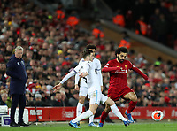 24th February 2020; Anfield, Liverpool, Merseyside, England; English Premier League Football, Liverpool versus West Ham United; Mohammed Salah of Liverpool  takes on Aaron Cresswell of West Ham United