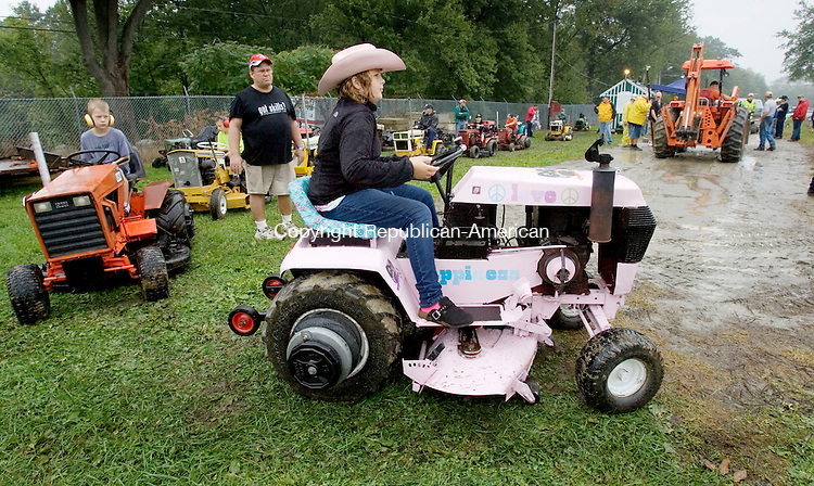 PLYMOUTH, CT. 27 August 2011-082711SV10--Cailin Ward, 9, of Warren lines up her pink tractor for the pull during the fair in Terryville Saturday.<br /> Steven Valenti Republican-American