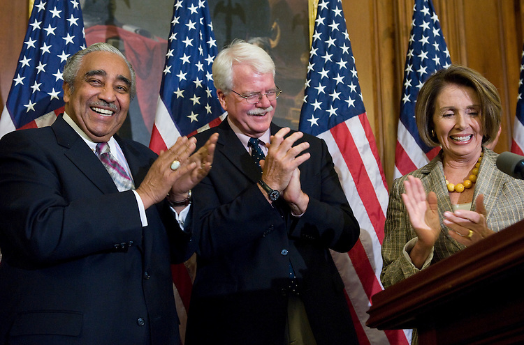 From left, House Ways and Means Committee chairman Charlie Rangel, D-N.Y., House Education and Labor Committee chairman George Miller, D-Calif., and Speaker of the House Nancy Pelosi, D-Calif., participate in a news conference on the House's healthcare reform bill on Friday, July 17, 2009.
