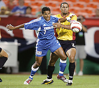 Diego Gutierrez battles C.J. Brown for the ball during.Kansas City's 1-0 victory over Chicago to win the US Open Cup, at Arrowhead Stadium, in Kansas City, MO, Wednesday, Sept., 22, 2004.