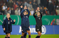 Lori Chalupny and Hope Solo acknowledge fans. US Women's National Team defeated Germany 1-0 at Impuls Arena in Augsburg, Germany on October 29, 2009.