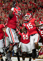 ATHENS, GA - SEPTEMBER 21: Isaiah Wilson #79 of the Georgia Bulldogs and teammate Lawrence Cager #15 celebrate after a touchdown during a game between Notre Dame Fighting Irish and University of Georgia Bulldogs at Sanford Stadium on September 21, 2019 in Athens, Georgia.