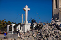A man prays at the heavily damaged National Cathedral in Port-au-Prince. The 7.0 earthquake that devastated parts of Haiti on January 12 killed hundreds of thousands of people. January's earthquake killed hundreds of thousands of people and caused significant and lasting structural and economic damage in the Caribbean nation.