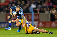 8th November 2019; AJ Bell Stadium, Salford, Lancashire, England; English Premiership Rugby, Sale Sharks versus Coventry Wasps; Byron McGuigan of Sale Sharks is tackled by Tommy Taylor of Wasps - Editorial Use