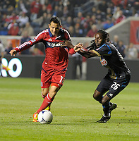 Chicago Fire midfielder Marco Pappa (16) dribbles in for the shot while being pressured by Philadelphia Union midfielder Keon Daniel (26).  The Chicago Fire defeated the Philadelphia Union 1-0 at Toyota Park in Bridgeview, IL on March 24, 2012.