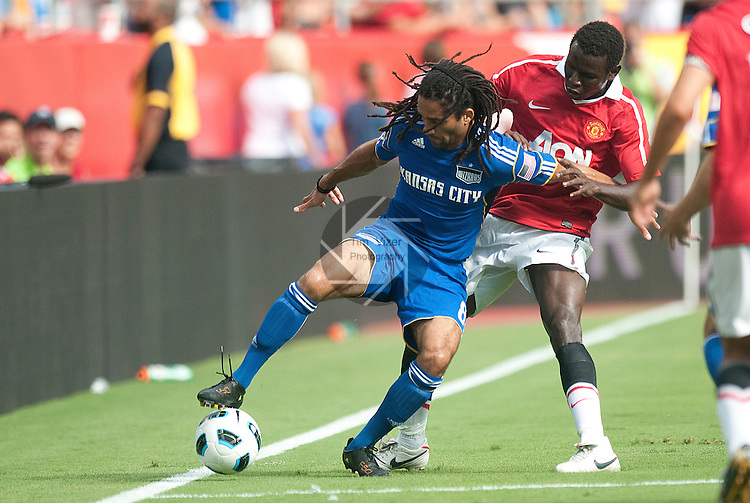 "July 25, 2010          Kansas City Wizards midfielder Stephane Auvray (8, left) tries to maintain control of the ball as he's pressured by Manchester United forward Mame Biram Diouf (32).  The Kansas City Wizards of Major League Soccer defeated Manchester United of the English Premier League 2-1 in an international friendly game on Sunday July 25, 2010 at Arrowhead Stadium in Kansas City, Missouri.  The game is the third of four stops for Manchester United on their ""Tour 2010""."