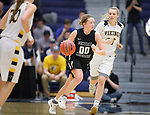 SIOUX FALLS, SD: MARCH 12:  Paige Redmond #00 of Central Missouri dribbles past Paige Peterson #23 of Augustana during the 2018 NCAA Division II Women's Basketball Central Region Championship Monday at the Elmen Center in Sioux Falls, S.D. (Photo by DIck Carlson/Inertia)
