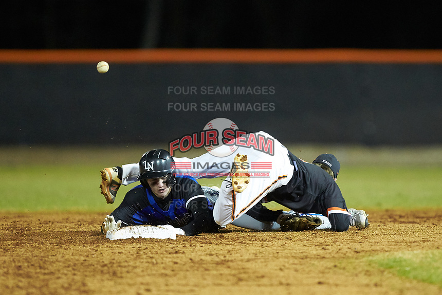 Davie War Eagles shortstop Michael Shelton (8) can't handle the throw as Vance Anderson (8) of the Lake Norman Wildcats steals second base at Davie County High School on March 7, 2018 in Mocksville, North Carolina.  The Wildcats defeated the War Eagles 12-0.  (Brian Westerholt/Four Seam Images)