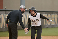 NWA Democrat-Gazette/BEN GOFF @NWABENGOFF<br /> Keelah Griffith, Bentonville left fielder, low-fives coach Kent Early after hitting a home run Thursday, March 16, 2017, during the softball game against Van Buren at Bentonville's Tiger Athletic Complex.
