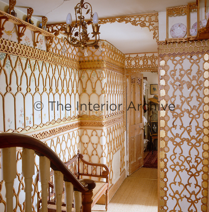 Ornate fretwork covers the walls of this upstairs landing
