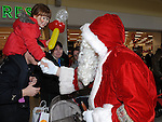 Aleshia Clarke from Duleek meets Santa at the Drogheda Town Centre. Photo: Colin Bell/pressphotos.ie