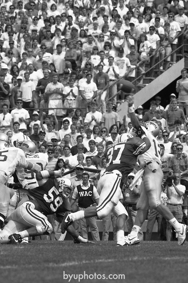 1304 Q 14a<br /> <br /> FTB 1304 A-R<br /> <br /> September 15, 1990<br /> <br /> Football - BYU vs. Washington<br /> <br /> Mark Philbrick A-KJ <br /> Rick Gleason K-R<br /> <br /> BYU Photo 2017<br /> All Rights Reserved<br /> photo@byu.edu <br /> (801) 422-7322