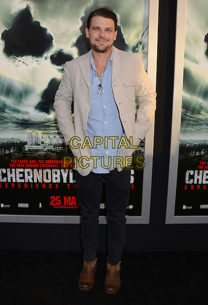 """Nathan Phillips.""""Chernobyl Diaries"""" Special Fan Screening held at the ArcLight Cinemas Cinerama Dome, Hollywood, California, USA..May 23rd, 2012.full length black jeans denim blue shirt beige jacket.CAP/ADM/BT.©Birdie Thompson/AdMedia/Capital Pictures. Pictures"""