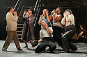 "London, UK. 16/09/2011. ""Street Scene"" by Kurt Weill (music) and Elmer Rice (book) returns to The Young Vic, London. 24 hours in the life of a 1940's New York City tenement on a hot summer's day with an eighty-strong cast, full choir and orchestra. L to R: Joseph Shovelton (as Lippo Fiorentino), Harriet Williams (as Mrs Olsen), James McOran-Campbell (as Mr Easter), Simon Suaphanor (as Mrs Fiorentino), John Moabi (as Dick McGann), Paul Reeves (as Mr Olsen). Photo credit: Jane Hobson"