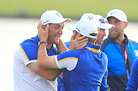 Sergio Garcia and Jon Rahm (Team Europe) hugging on the 18th green after Europe won the Ryder Cup, Le Golf National, Ile-de-France, France. 30/09/2018.<br /> Picture Thos Caffrey / Golffile.ie<br /> <br /> All photo usage must carry mandatory copyright credit (© Golffile | Thos Caffrey)