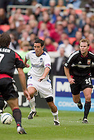 San Jose Earthquakes' Ian Russell faces D.C. United's Ryan Nelsen as Bryan Namoff trails. DC United defeated the San Jose Earthquakes 2 to 1 during the MLS season opener at RFK Stadium, Washington, DC, on April 3, 2004.