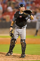 Catcher Adam Ricks #7 of the Birmingham Barons waits for a new baseball from the home plate umpire at Five County Stadium August 15, 2009 in Zebulon, North Carolina. (Photo by Brian Westerholt / Four Seam Images)