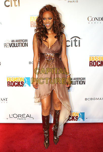 TYRA BANKS.At Fashion Rocks held at Radio City Music Hall,.New Tork, 8th September 2005.full length brown chiffon layer v-nwck gold beading dreaa boots knee.Ref: ADM/JL.www.capitalpictures.com.sales@capitalpictures.com.© Capital Pictures.