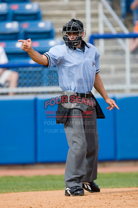 Home plate umpire Joey Amaral makes a strike call during a Carolina League game between the Kinston Indians and the Salem Red Sox at Lewis-Gale Field May 2, 2010, in Winston-Salem, North Carolina.  Photo by Brian Westerholt / Four Seam Images