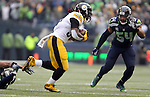 Pittsburgh Steelers running back DeAngelo Williams (34) puts Seattle Seahawks free safety Earl Thomas on his back at CenturyLink Field in Seattle, Washington on November 29, 2015.  The Seahawks beat the Steelers 39-30.      ©2015. Jim Bryant Photo. All Rights Reserved.