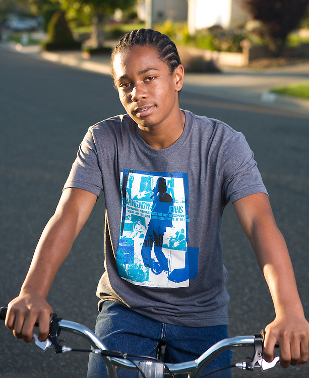 August 14, 2006; Oakland, CA, USA; Portrait of a teenage boy on his bicycle in Oakland, CA. Photo by: Phillip Carter