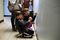 NWA Democrat-Gazette/CHARLIE KAIJO Harvey Luhtanen, 4 and Norah Luhtanen, 7, of Bentonville (from left) write on the wall, Saturday, November 3, 2018 at the Helen Walton Children&Otilde;s Enrichment Center in Bentonville.<br />