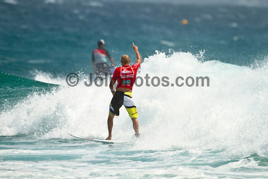 Mick Fanning (AUS)  SNAPPER ROCKS, Queensland/Australia (Wednesday, March 3, 2010) - With pumping three-to-five foot (1 - 2 metre) waves running down the point at Snapper Rocks today, Round 3 of the Quiksilver Pro Gold Coast presented by Land Rover went off in front of a capacity crowd on the beach and hundreds of thousands watching online and FUEL TV.     The opening event of the 2010 ASP World Tour season, the Quiksilver Pro Gold Coast has consolidated the greatest assemblage of surfing talent in history, and with one of the most iconic pointbreaks in the world firing throughout the day, the world's best put on an incendiary performance.    Bede Durbidge (AUS), 27, current ASP World No. 3, proved the form surfer of the day, posting a near-perfect 19.30 out of a possible 20, to dispatch of Luke Munro (AUS), 27, in their Round 3 bout. Durbidge blended deep tube rides with progressive forehand gaffs en route to his emphatic victory, even posting the day's highest single wave score of a 9.93 out of a possible 10. . Kelly Slater (USA), 38, former nine-time ASP World Champion and current ASP World No. 6, negotiated the varying afternoon conditions today, putting in a solid performance against 2010 ASP Dream Tour rookie Patrick Gudauskas (USA), 24, in Round 3..Mick Fanning (AUS), 28, reigning two-time ASP World Champion, continued his searing form through Round 3 today, besting 2010 ASP World Tour rookie Brett Simpson (USA), 25, with an intimate rapport with the Snapper Rocks sand bank. .Joel Parkinson(AUS) also put in one of the performances of the round picking up two 8 point rides in the opening minutes of his heat with barreling waves form behind the Snapper Rocks. Photo: joliphotos.com