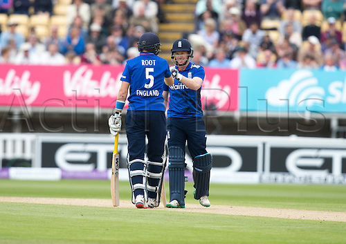 09.06.2015.  Birmingham, England. T20 One Day International. England versus New Zealand. Joe Root of England is congratulated by Eoin Morgan of England after Root hit a drive for four runs.
