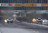 Apr. 26, 2013; Baytown, TX, USA: NHRA funny car driver Cruz Pedregon (left) races alongside Matt Hagan during qualifying for the Spring Nationals at Royal Purple Raceway. Mandatory Credit: Mark J. Rebilas-