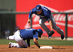 Texas Rangers' Shin-Soo Choo dives back into second base against Los Angeles Dodgers' Kike Hernandez during a spring training game in Surprise, Ariz., on Saturday, March 26, 2017.<br /> Photo by Cathleen Allison/Nevada Photo Source
