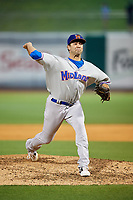 Midland RockHounds relief pitcher Lou Trivino (56) delivers a pitch during a game against the Northwest Arkansas Naturals on May 27, 2017 at Arvest Ballpark in Springdale, Arkansas.  NW Arkansas defeated Midland 3-2.  (Mike Janes/Four Seam Images)