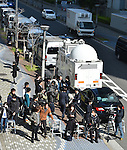 March 27 2015, Tokyo, Japan - Media awaits stockholders arriving for the annual shareholders meeting of Japan's leading furniture reail chain Otsuka Kagu Ltd. in Tokyo on Friday, March 27, 2015. A feud between the founder-chairman Katsuhisa Otsuka and his daughter-president Kumiko Otsuka over the corporate governance has resulted in a proxy fight between the two, with the result expected to decide the fate of the badly shaken furniture giant.  (Photo by Natsuki Sakai/AFLO)